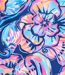 Lilly Pulitzer print featuring feminine flowers paired with large shells in a coral and aqua colorway on a solid navy background