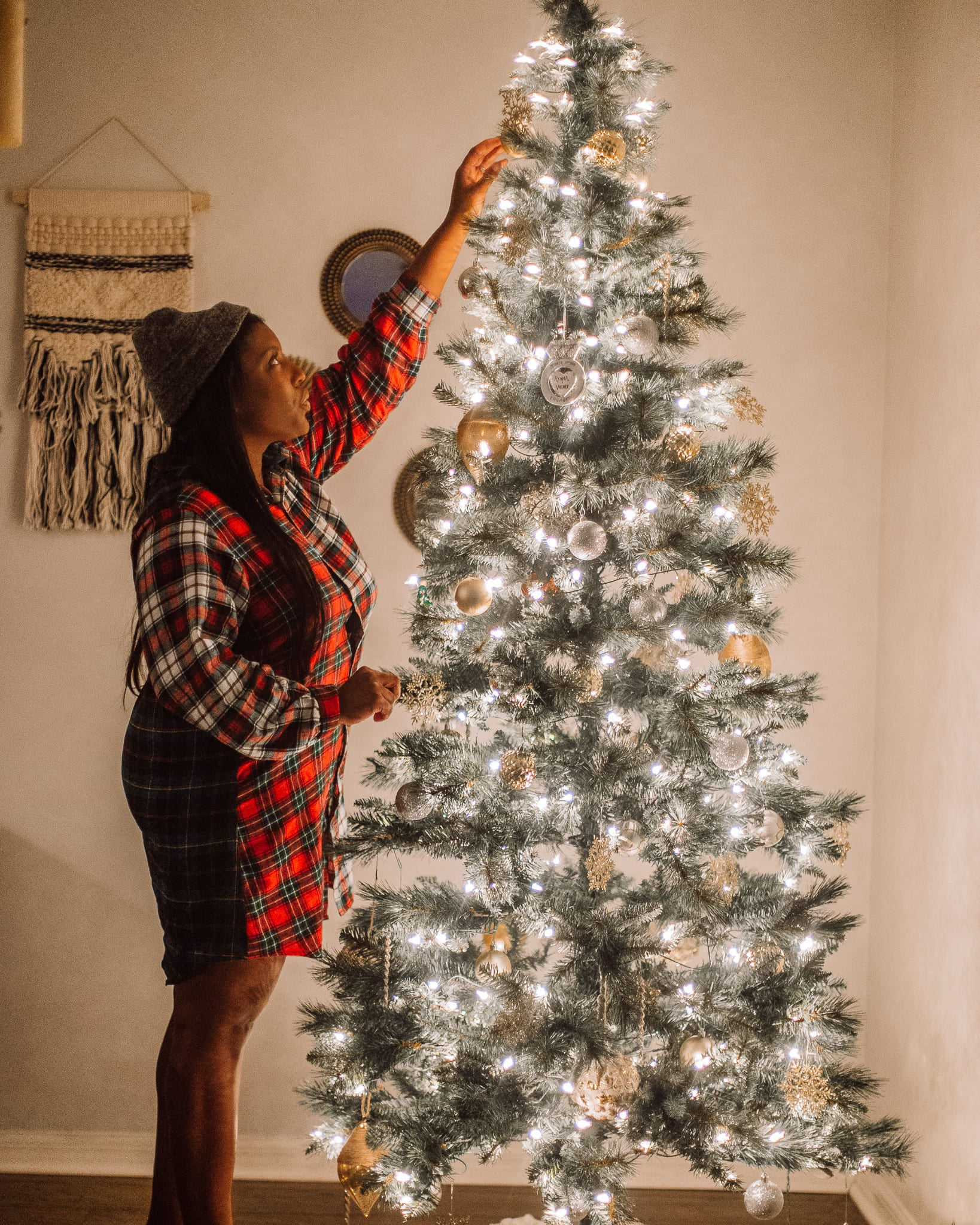 Tampa Blogger Ayana Lage stands next to a lit Christmas tree