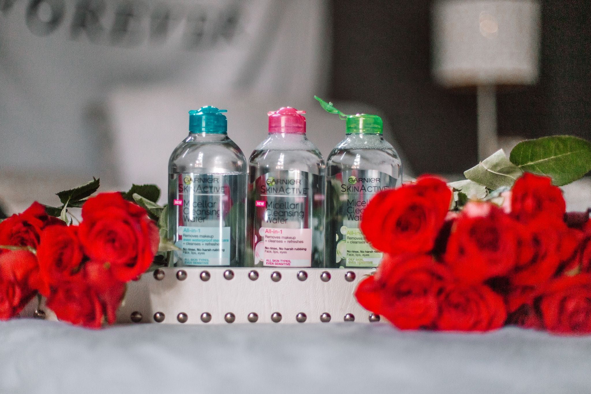 Garnier Micellar Water surrounded by roses