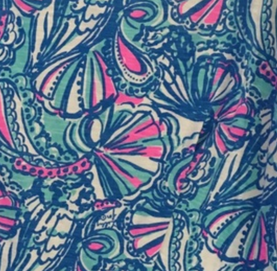 Lilly Pulitzer x Target Collaboration print with pink and aqua shells in a intricate design on a white background