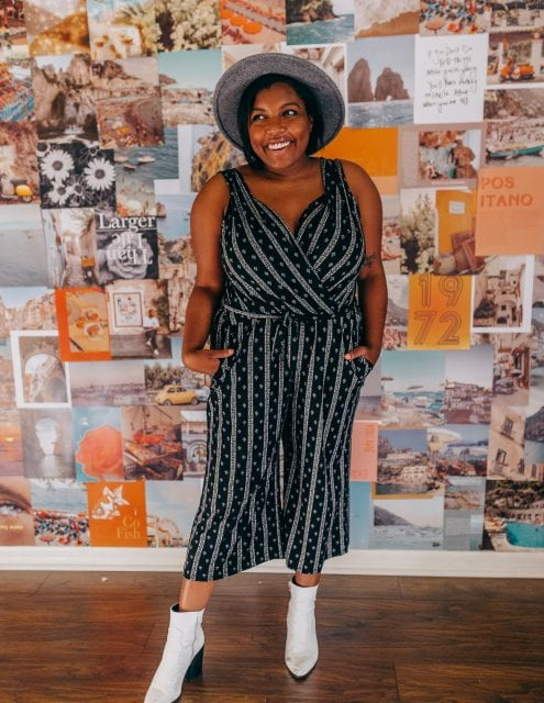 tampa blogger ayana lage wearing a plus-size jumpsuit from stitchfix and white boots from nastygal