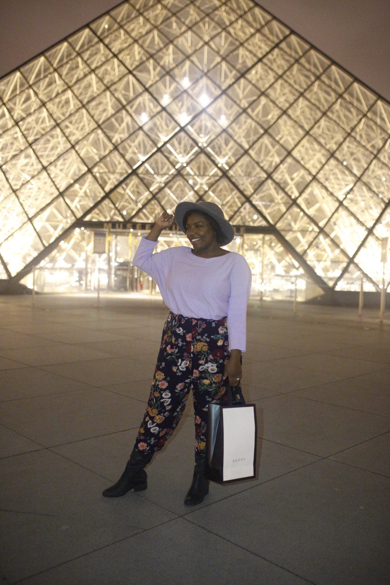 tampa bloger ayana lage stands in front of the louvre museum in paris, france