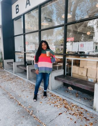 tampa blogger ayana lage stands outside of bandit coffee in st. petersburg, florida